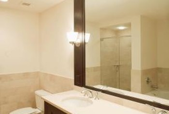 Adhesive holds large bathroom mirrors in place.