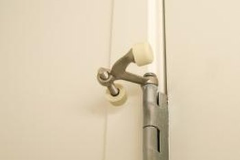 Hinge-pin door stops install directly into the door hinge.