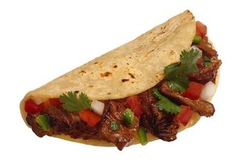 Pick meat or fish fajitas for a higher protein content.