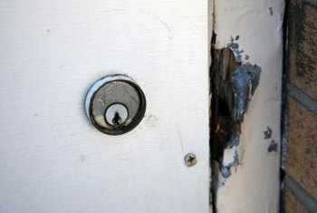 Smashed or jimmied front door locks provide an entryway for robbers.