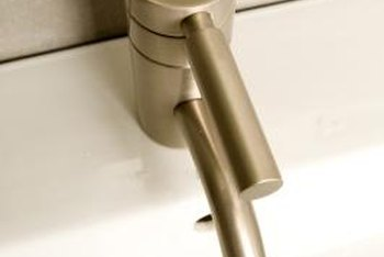 Bathroom sink stoppers operate by pushing a lever to close and lifting to open.