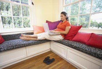 Colorful cushions enhance built-in seating in front of windows.