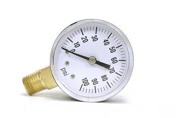 A gauge screws into a yard tool to measure internal pressure.