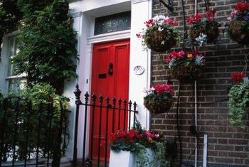 White trim, dark brick and a cherry red door make a cheerful statement.