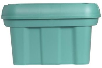 A plastic storage bin is the basic building block for a thrifty urban garden.
