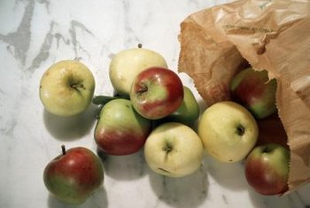 Brown paper bags help ripen apples, bananas and other fruits.
