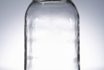 Convert an empty glass jar into a simple sprouter.