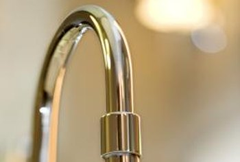 Remove scratches from a polished chrome faucet with a soap pad.