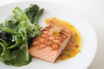 Salmon and green leafy vegetables contain nutrients that help maintain your vision.