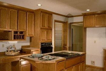 Matching cabinets and countertops helps a small kitchen appear bigger.