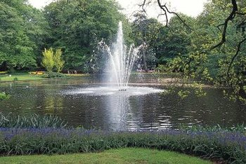 A fountain can help aerate water in a pond.