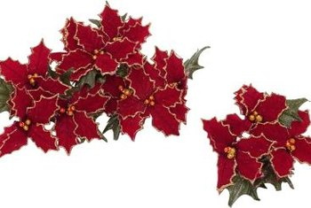 Vibrant-red, artificial poinsettias pop with color in a bleak winter landscape.
