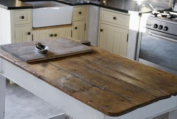 White distressed kitchen cabinets add to the charm of cottage decor.