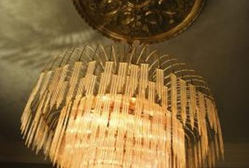 Chandelier medallions surround the canopy of the light fixture.