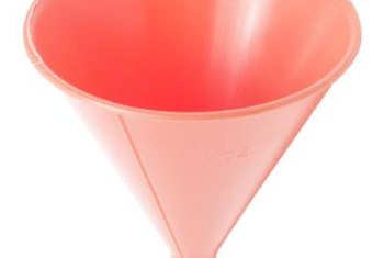 A funnel helps prevent spills during the oil change.