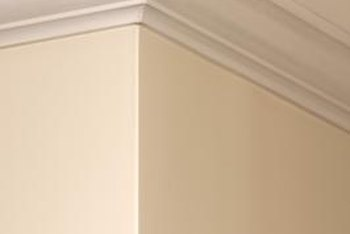Painter's tape can help keep ceiling paint off your walls and molding.