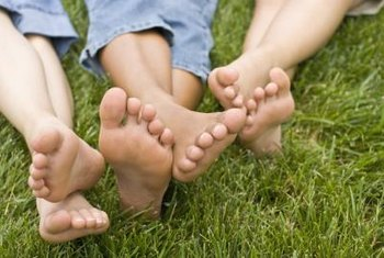 Carpet grass forms a dense mat of green for barefoot play in shady locations.