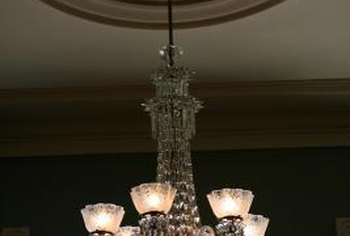 A chandelier adds drama to a tray ceiling.