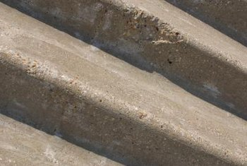 Adding veneer to your concrete steps will liven up their appearance.