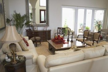 Light Colored Sofas And Chairs Help Brighten A Living Room