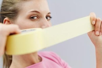 Tan masking tape may lift off paint when you remove it.