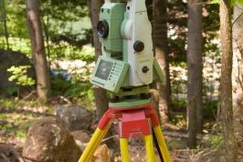Surveyors use sophisticated equipment and high-level math to determine property boundaries.