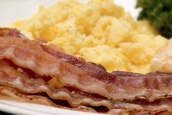 Bacon contains beneficial protein, iron and vitamin B-12, but also contains sodium and saturated fat.