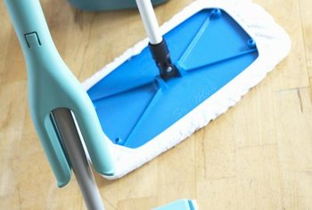 Flat microfiber mops clean engineered wood floors safely and effectively.