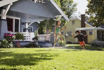 Let soaker hoses irrigate garden beds, but leave the lawn to sprinklers.