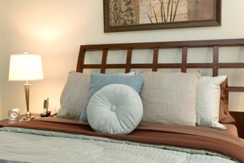 Even ornate headboards benefit from something hung in just the right spot.