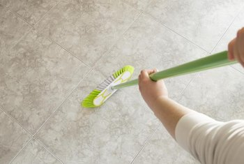 A rubber-bristled broom attracts hair for easy cleanup.