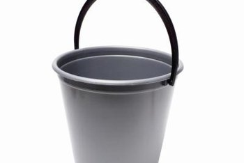 Buckets with handles require minimal modifications to turn into hanging planters.