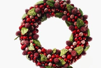wreaths crafted from fruit add a colonial touch to your christmas decor