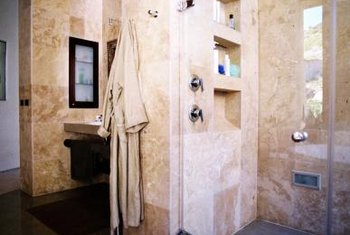 Frameless glass shower doors let the marble patterns and colors shine through.