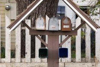Mount the newspaper holder under your mailbox for more rain protection.