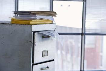 Repurpose an old office filing cabinet to make an attractive storage piece.