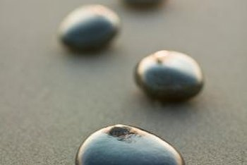 Black shiny pebbles can make an area stand out.