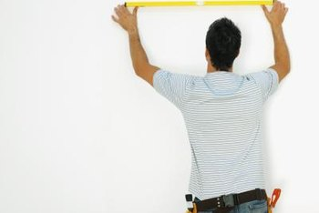 Skip the onerous wallpaper installation and paint stripes on your wall.