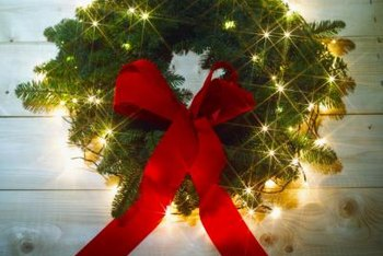 The lighted wreath that graces your porch sparkles even brighter in a window.