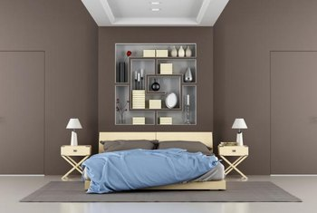 Lighter color bedding balances a bedroom with brown walls.