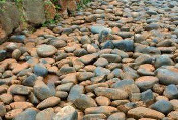 Pebbles can make an interesting rustic path in your yard.