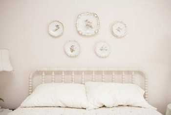 Soft colors, minimal furnishings and plenty of wall space give an airy feeling to the bedroom.