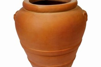 A cascading clay pot water feature adds interest to any garden spot.