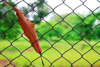 Cover a chain-link gate to increase privacy.