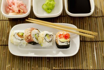 Sushi is commonly served with pickled ginger, wasabi and soy sauce.
