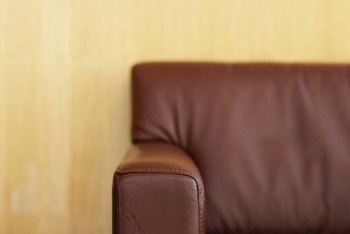 Painting your walls in a light, warm color helps to soften the look of brown leather pieces.