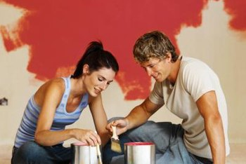 For a tan wall, this couple has selected an orange-red accent wall color.