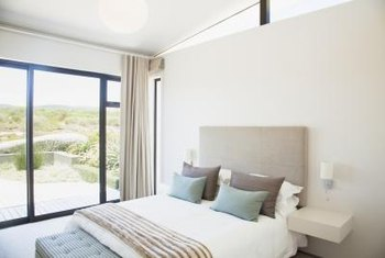 Soft coastal colors enhance the serenity of a seaside cottage bedroom.