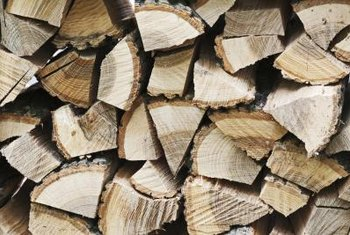 Chopping wood into small logs can help it dry faster.