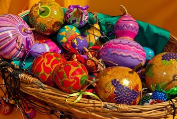 Small polished and painted gourds make attractive Christmas-tree decorations.